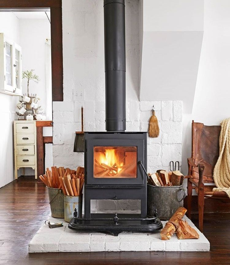 Wood Stove Hearth Designs: Fireplace With White Painted Brick