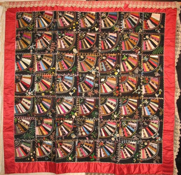 FANS crazy type quilt, late 19th century all silks with wonderful embellishment, including metallic threads, variety of embroidery stitches. Small scale blocks, all original including lace edging.