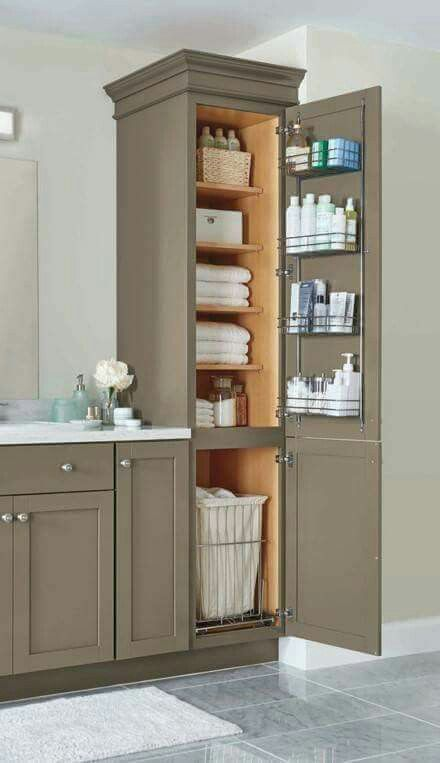 bathroom linen closet with four adjustable shelves a chrome door rack and a pull out hamper helps keep your home neat and organized