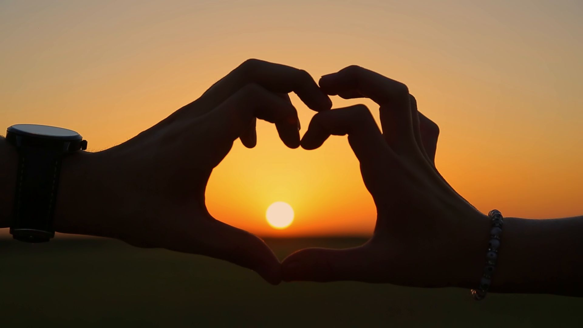 Person Making Heart With Hands Over Nature Sunset Background Happy People Stock Footage Hands Nature Sunset Sunset Background Graphic Design Art Illustration Hand shaped love wallpaper in sunset