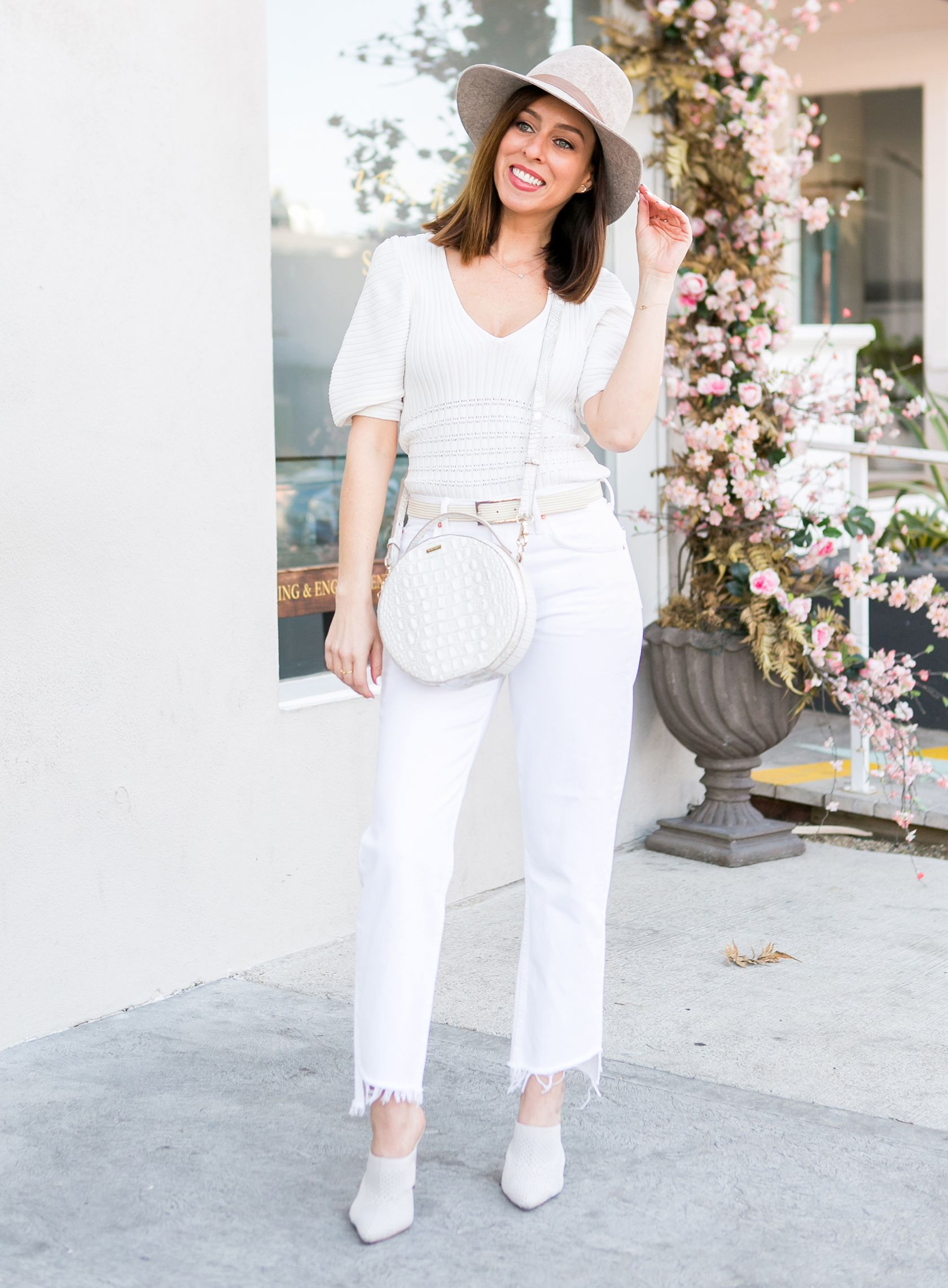 b47681646a67 Sydne Style shows all white outfit ideas for spring in grlfrnd jeans  white   whitejeans  springtrends  revolve  mules  hats  janessaleone  brahmin   ...