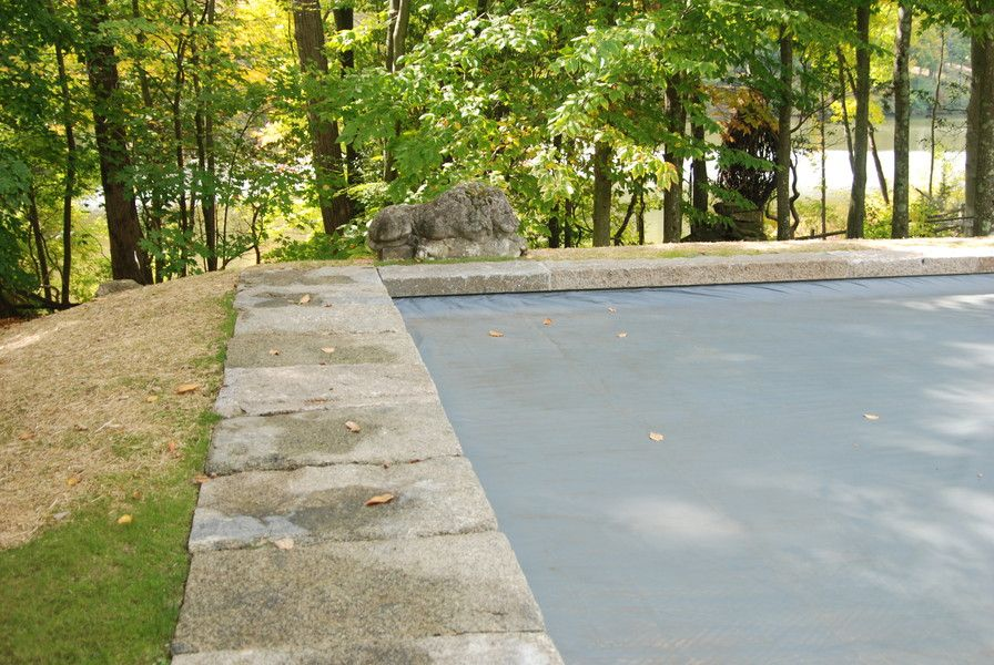 Reclaimed Granite Pool Coping Allows This Pool To Blend In Seamlessly With  Its Wooden Surroundings