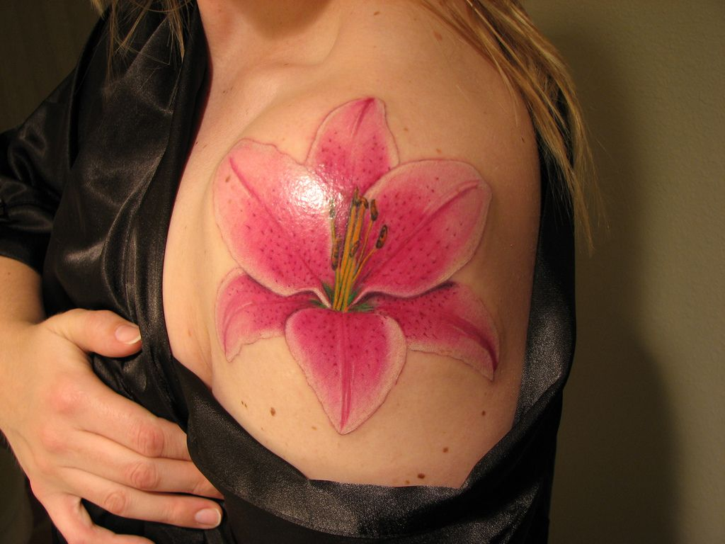 Flower tattoo designs for women design art flower tattoo lily flower tattoos are much loved by women belonging to different ethnicity and races these flower izmirmasajfo Gallery