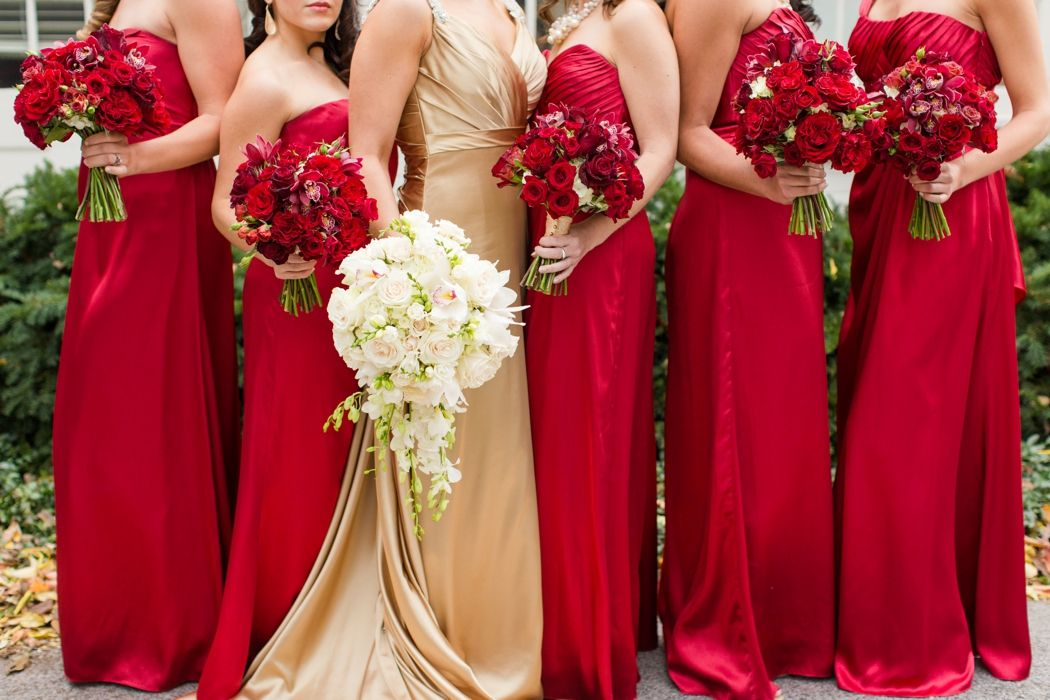 6360c85f9d Gold Wedding Dress with Red Bridesmaid Dresses and Flowers ...