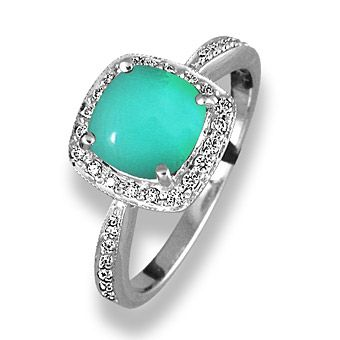 a princess cut turquoise stone is set in 18kt white gold and surrounded by round - Turquoise Wedding Rings