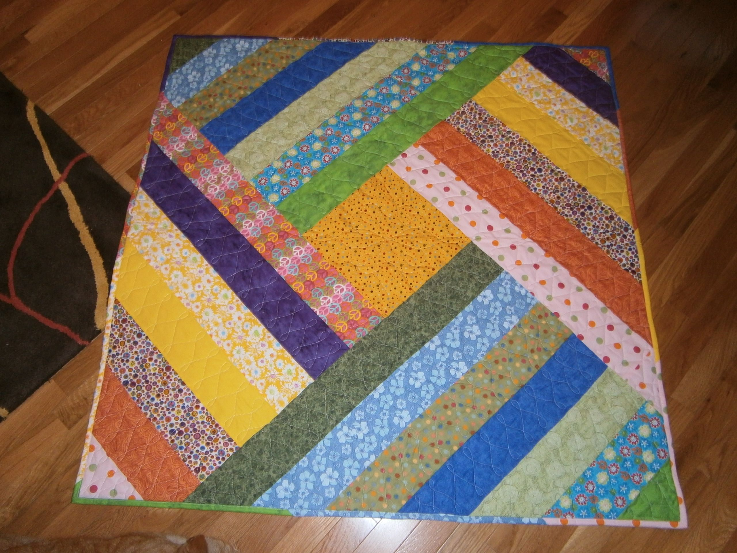 Fotos de tapetes de retalhos costurados