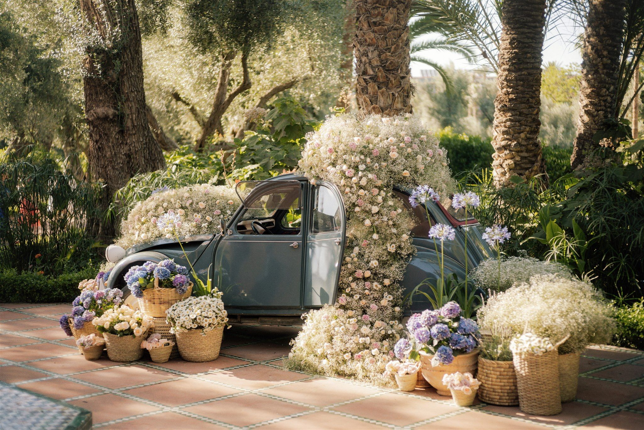 A flower filled vintage car, the perfect photo prop for