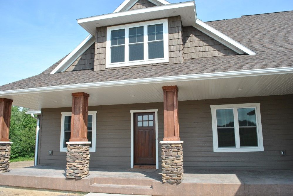Exterior with gray siding cedar and white trim and stone for Houses with stone accents