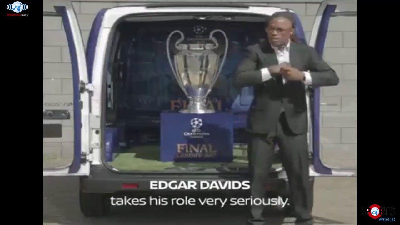Edgar Davids leads the UEFA Champions League trophy