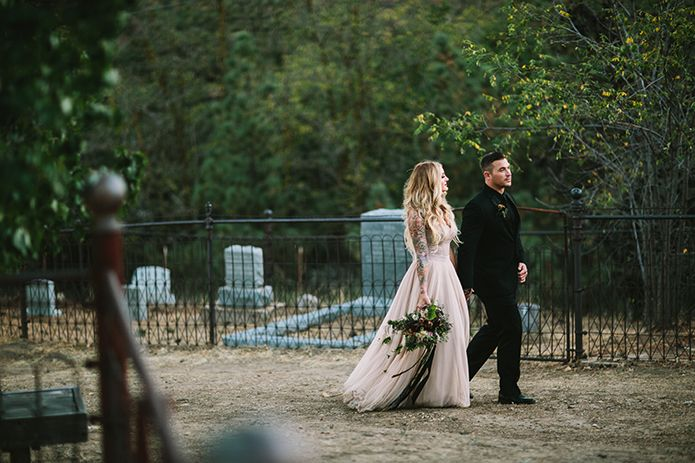Spellbound Halloween Graveyard Wedding With The Bride In A Watters Gown And Groom In A Black Tuxedo B Halloween Wedding Wedding Inspiration Fall Gothic Wedding