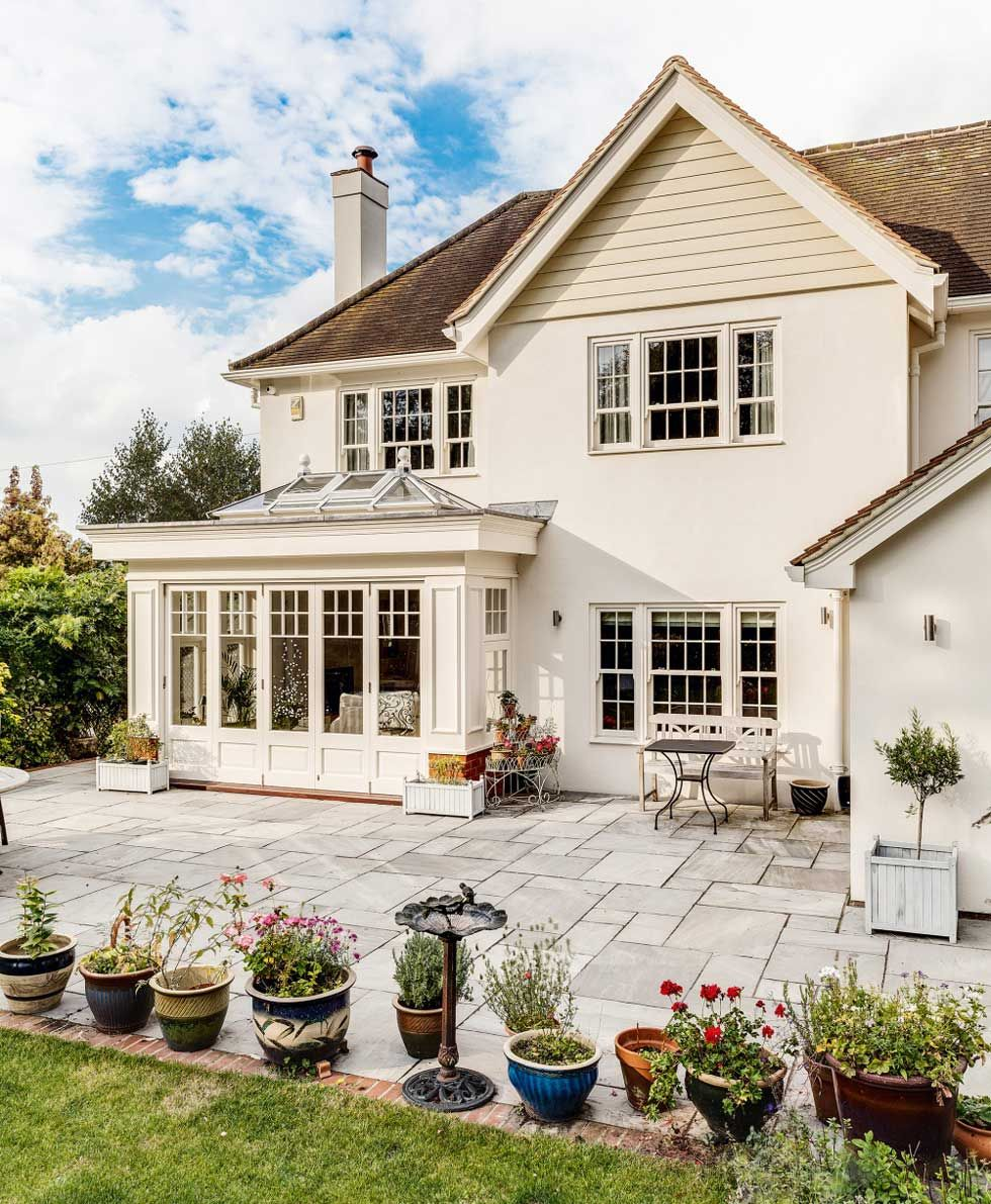 The large patio terrace at the rear of the house | Curb Appeal ...