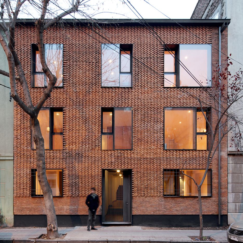 Mapa updates chilean housing block with textured brick Architecture home facade