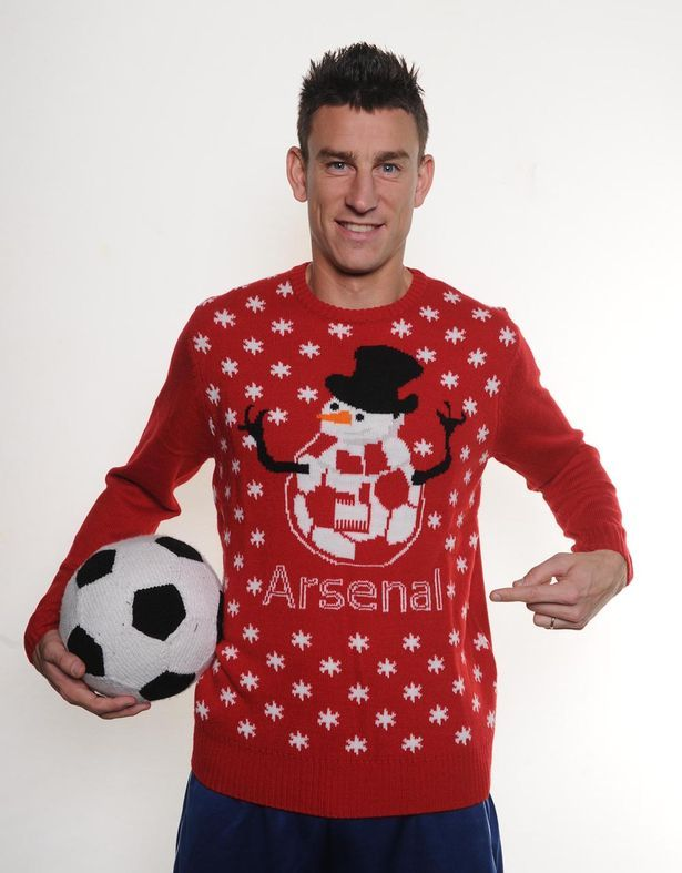 e6f93e1fc64 Laurent Koscielny models the Arsenal Christmas sweater as part of ...