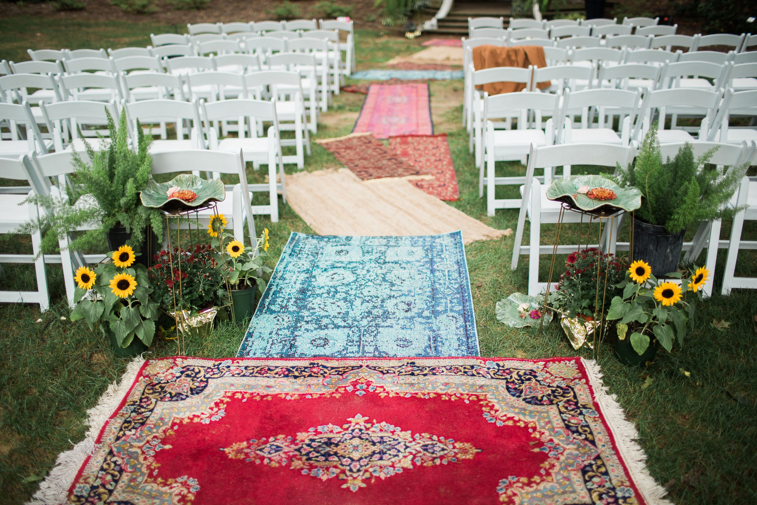 Colorful carpet aisle runner outdoor wedding ceremony