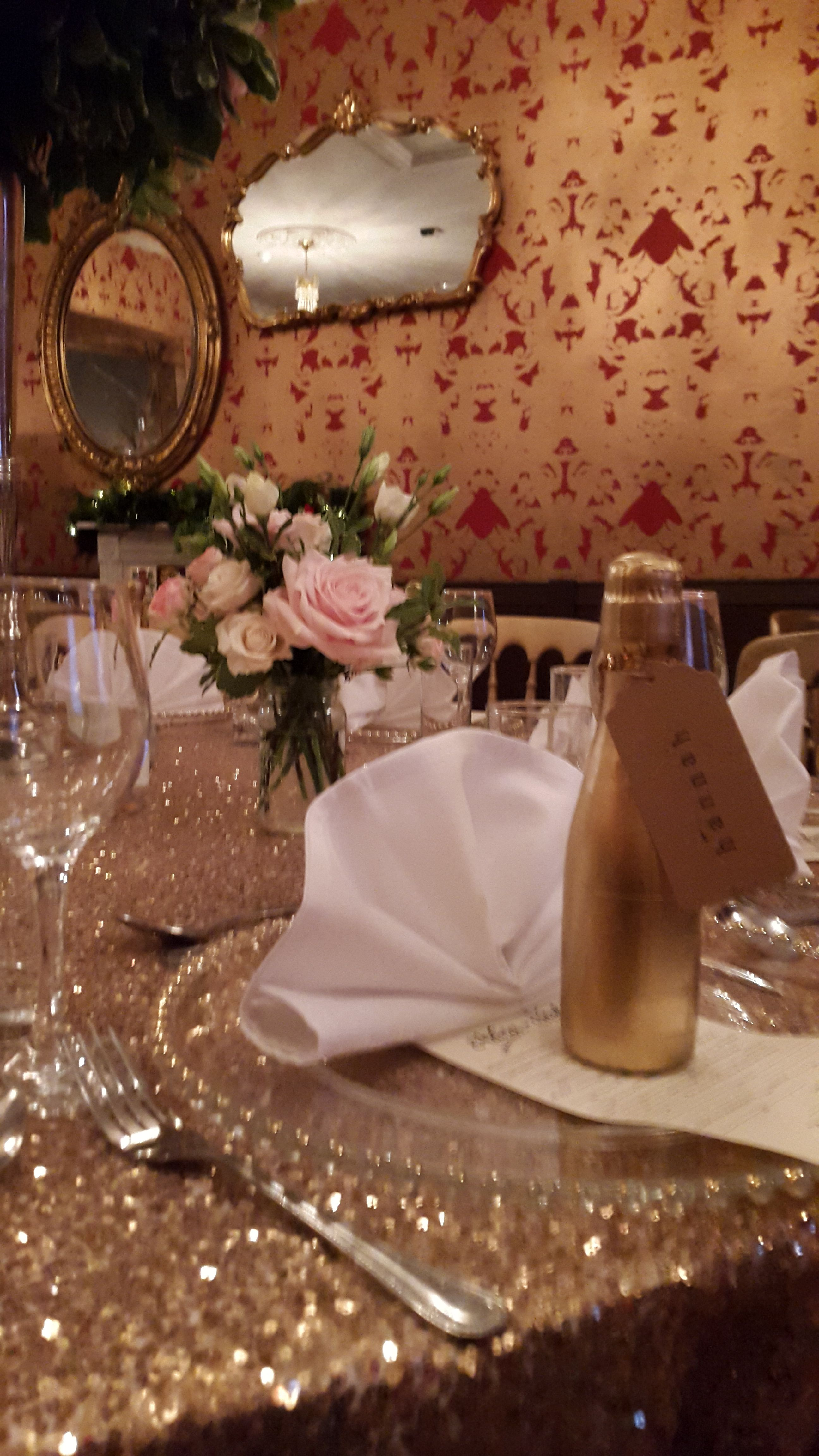 The Bell In Ticehurst East Sus Quirky Wedding Venue Sparkly Table Cloths With Mini Champagne As Favours