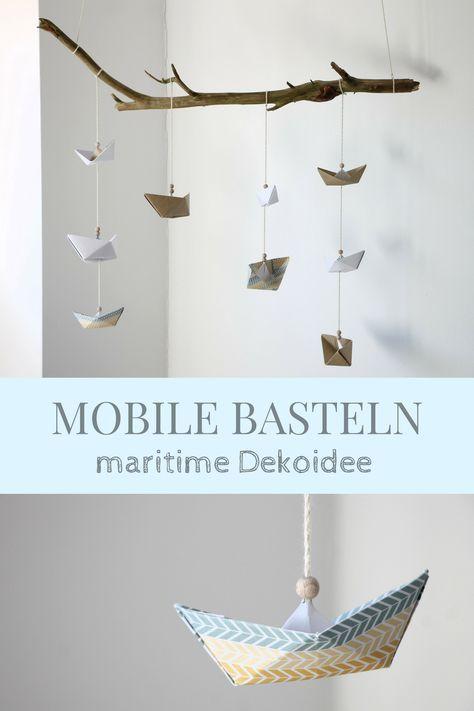Photo of Mobile basteln: Anleitung für ein Papierschiffchen-Mobile