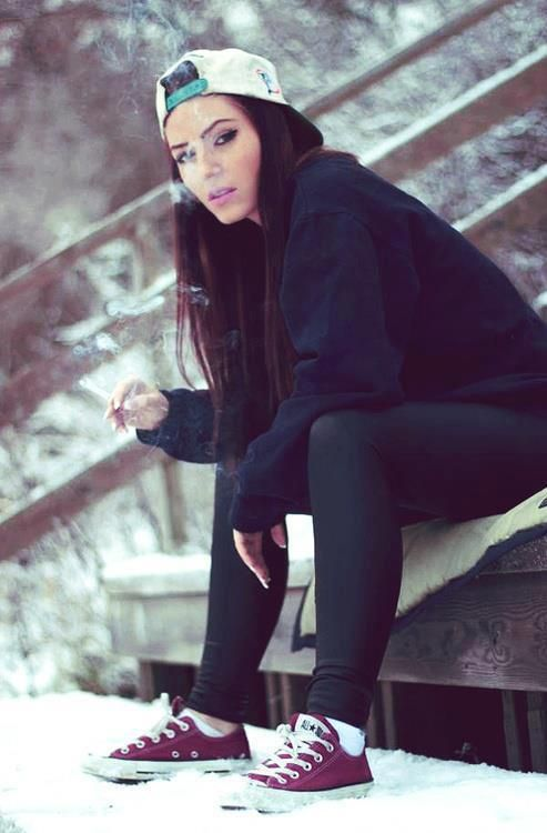 Girl smoking, backwards cap, skinny jeans & converse
