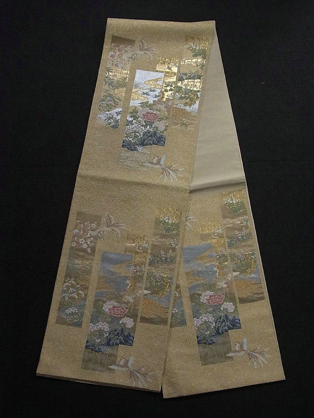 This is an elegant Fukuro obi with seasonal flowers and phoenix motifs on tanzaku (strip of paper) pattern, which is woven.