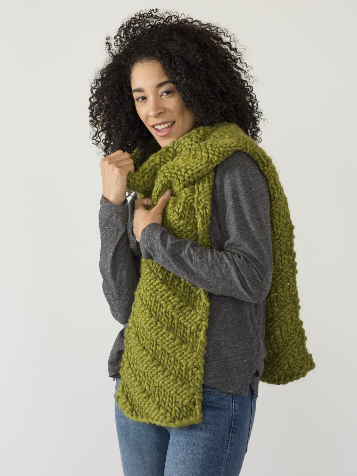 Knit this cozy scarf in no time! A diagonal textured pattern keeps ...