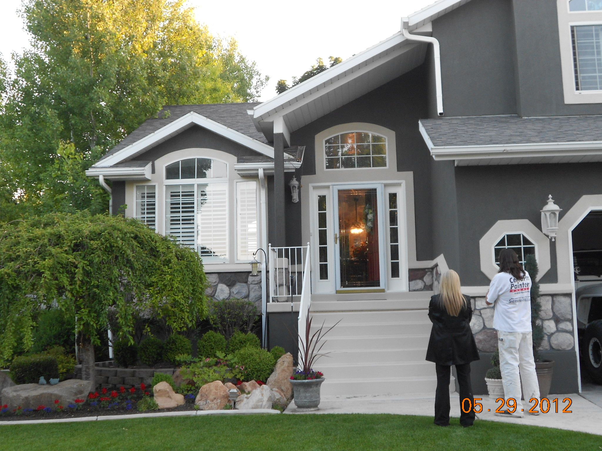 Dark gray stucco home painted by certapro painters of for Stucco house paint colors