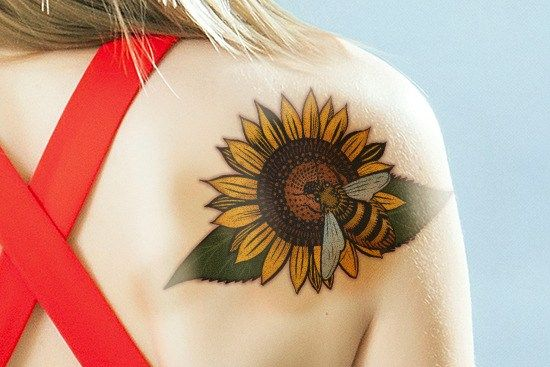 Cool sunflower tattoo on Shoulder Blade