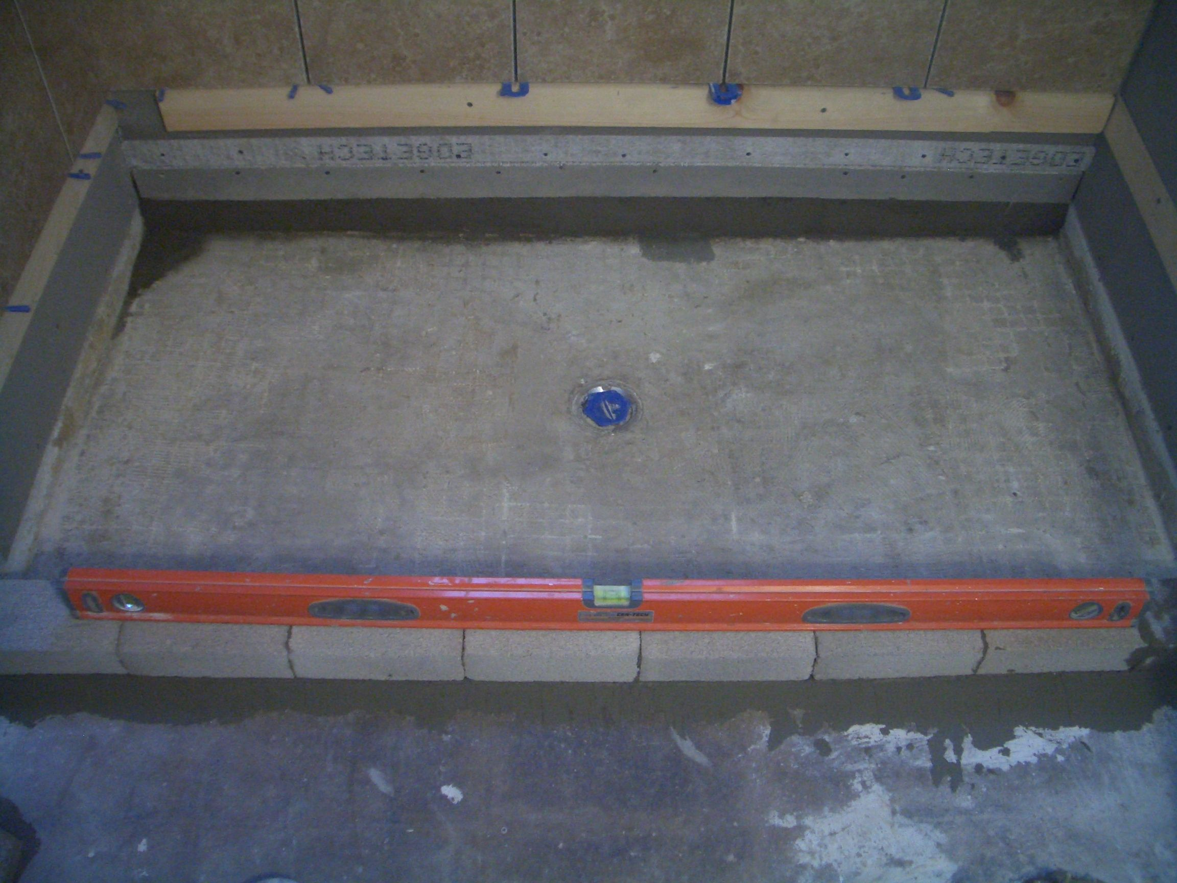 Building A Concrete Shower Pan On A Basement Floor. Brick Curb For A Shower