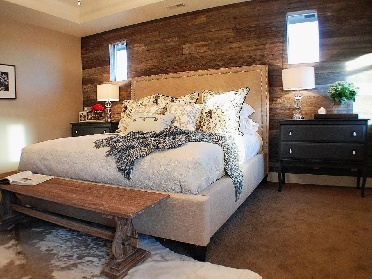 the warm color palette of brown and beige in this bedroom is best