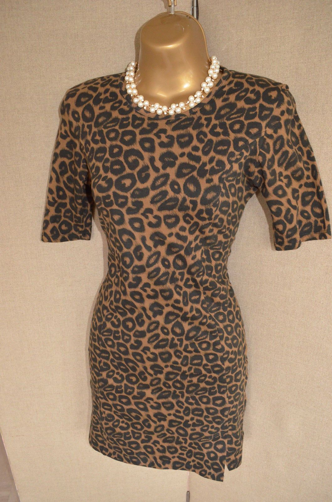 Designer leopard print dress with a black mess insert at the back