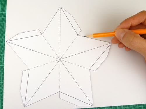 Making double sided 3d star christmas decoration step 1 for 3d paper star decoration