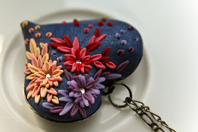 Polymer clay. Heart in bloom pendant. This is beautiful.