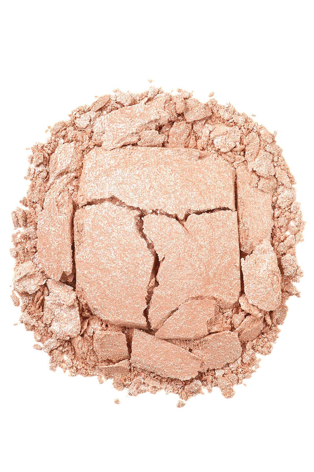 Give bare skin—shoulders, collarbones and the length of legs—a hint of sexy shimmer with Urban Decay Naked Illuminated Shimmering Powder for Face and Body, $29, urbandecay.com.   - HarpersBAZAAR.com