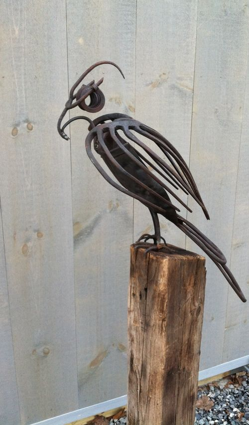 Reclaimed pitchfork bird sculpture