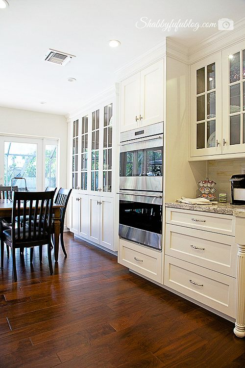 Ideas To Hack Of A High End Kitchen Remodel In Miami With White Cabinets Granite Counters Hardwood Floors And Elegant Lighting