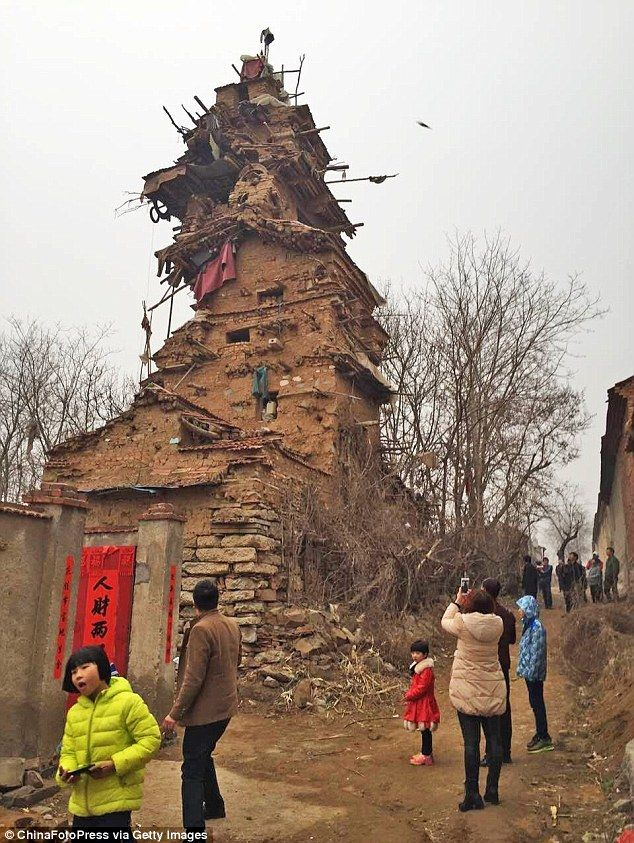 Hu Guangzhou, 55, said the building is for his brothers to move into when they come back - but they have been dead for ten years, according to local papers.