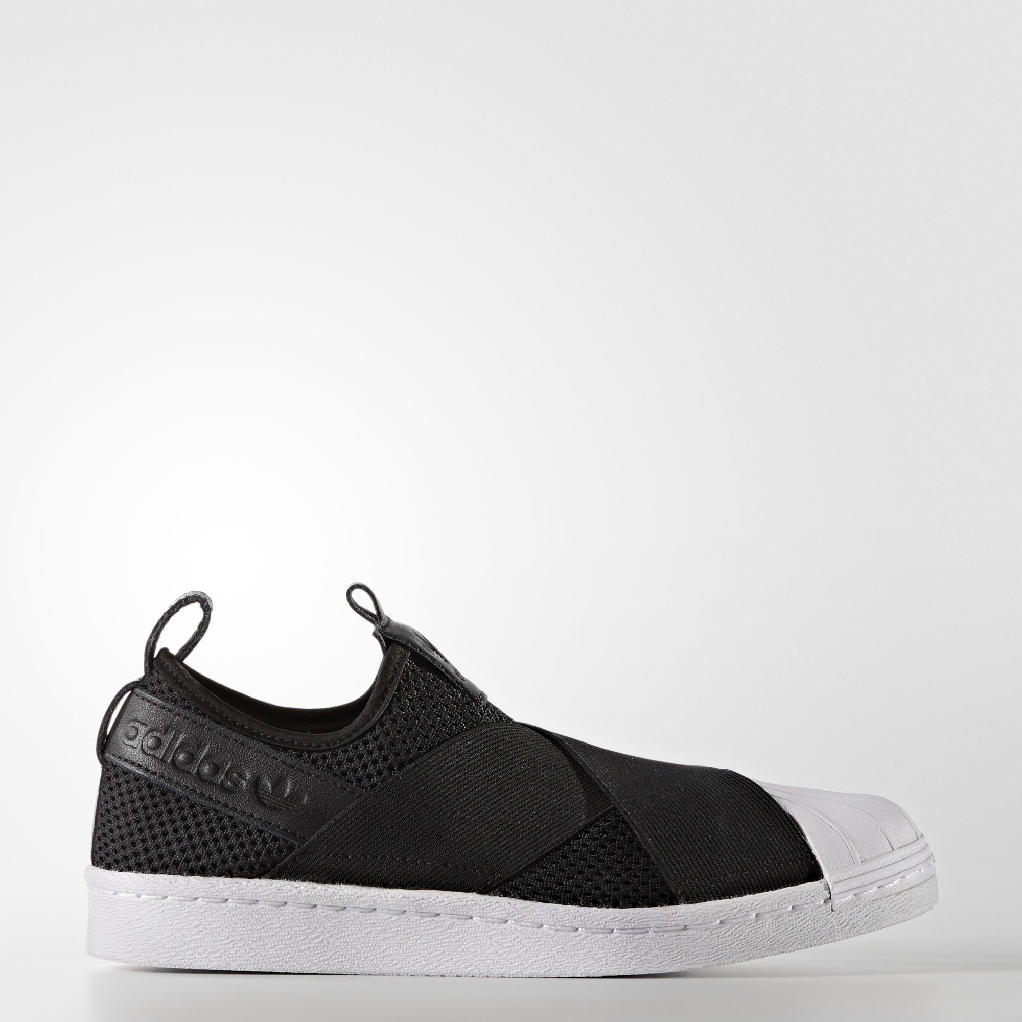 official photos 433ec b2a20 This version of the iconic adidas Superstar sneaker has an easy, slip-on  design. These women s shoes are made with a knit upper plus premium suede  overlays.
