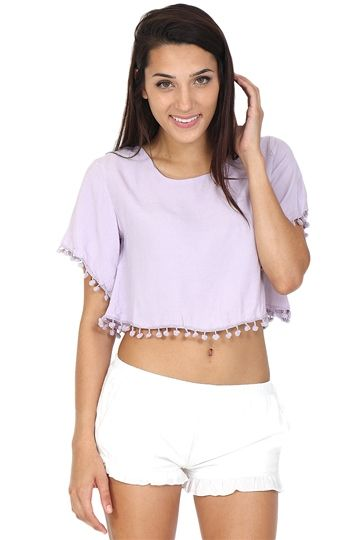 Lilac crop top featuring pom pom detailing all over. We're ready to feel hot and spicy in this top! Perfect for a night full of dancing.