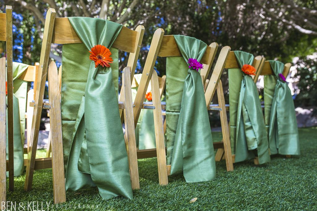 Chair ties with flower accent.  Garden ceremony.  BTS Event Management