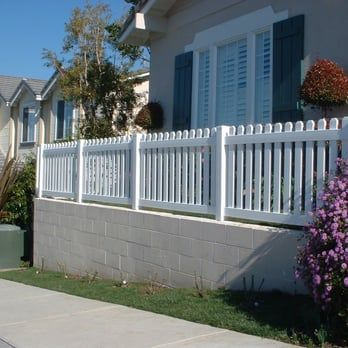 White Vinyl Picket Fence On Top Of A Block Wall Yelp Front Yard Fence White Picket Fence Front Garden