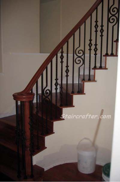 Custom Decorative Iron Remodel with stained handrail