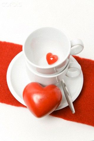 Small and large heart with coffee cups