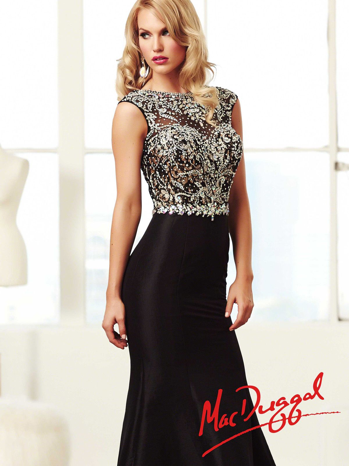 This elegant Mac Duggal prom dress is truly an unique gown you will ...
