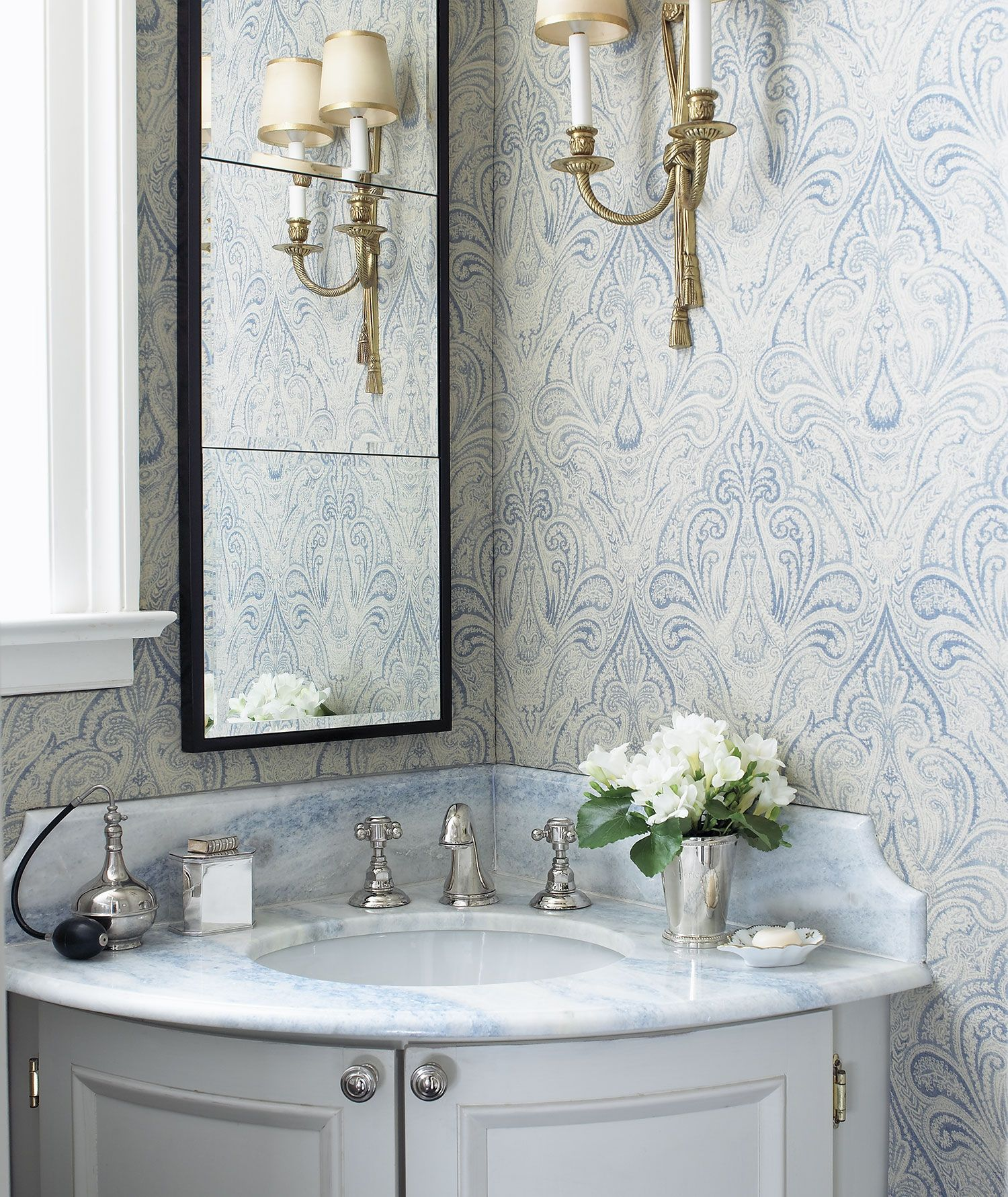 Corner Vanity With Blue Grey Woodwork Paired With Mirror On One Wall