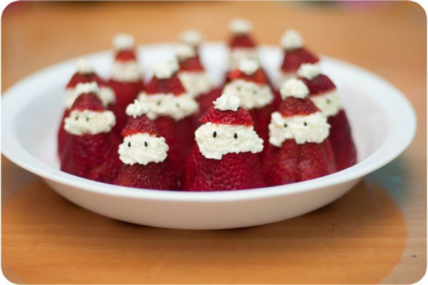 Strawberry Santa- made with just whipped cream and black sesame seeds as eyes - so simple