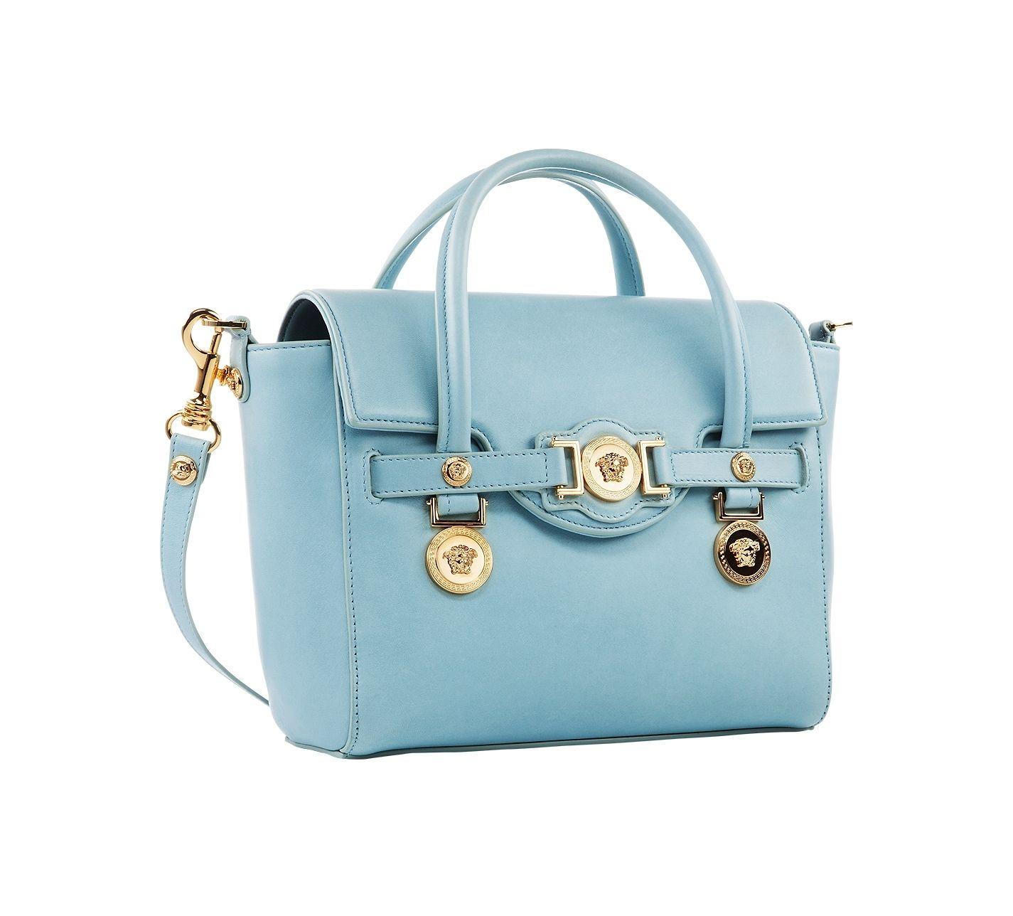 A small light blus Signature bag. #VesraceSignatureBag