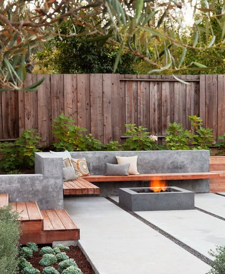 L shaped wooden seating with concrete back and square fire for L shaped garden designs images