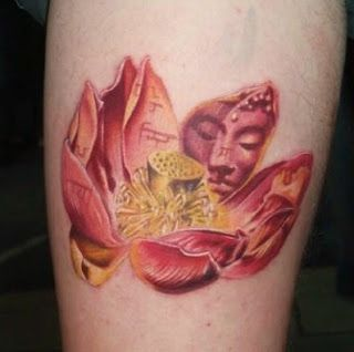Beautiful idea putting script and buddhas face on the lotus petals very nice buddhist tattoo that incorporates the symbolic lotus flower and the image of buddha mightylinksfo