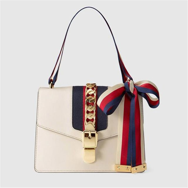 1e4eb5034b15a2 Gucci Sylvie leather bag DUPE! Genuine Gucci: $2,490 Dupe: $57.29.Check out  my blog for the link on AliExpress and more dupes and tips on how to  navigate ...