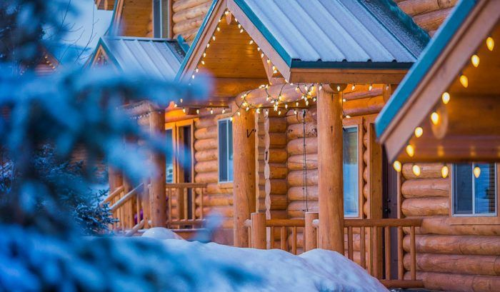 Photo of Explore The Forest On A Snowmobile, Then Snuggle Into The Cabins At Bear River Lodge In Utah