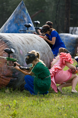 Find the worst bridesmaids dress you can find and play paintball for your bachelorette party. LoL Funny!