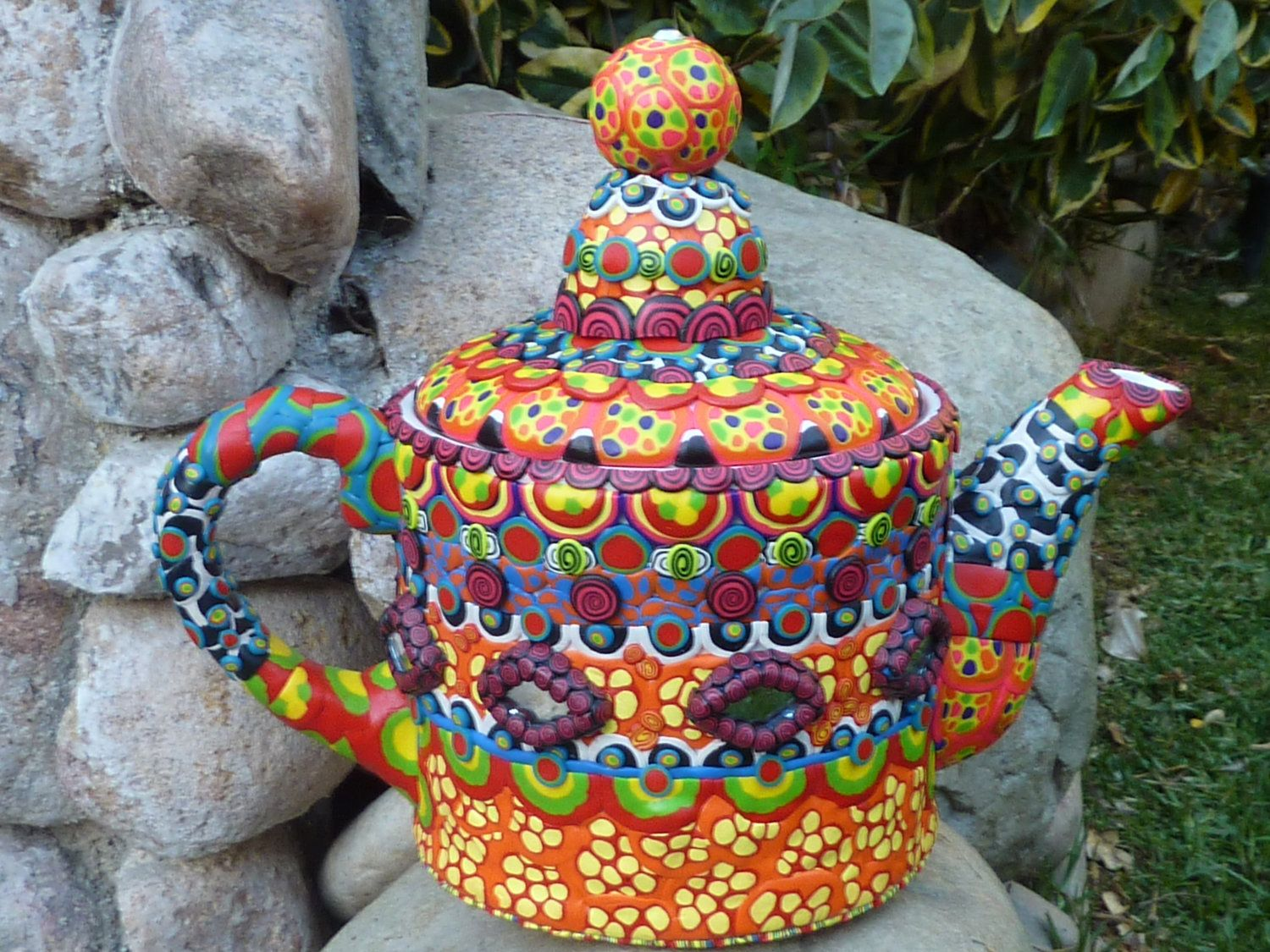Mad Hatter's Teapot Clay Mosaic Decorated with Shisha Mirrors. $165.00, via Etsy.